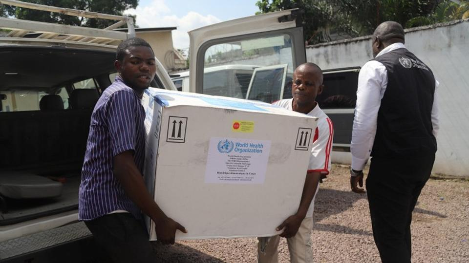 Congolese health ministry officials carry the first batch of experimental Ebola vaccines in Kinshasa, Democratic Republic of Congo on May 16.