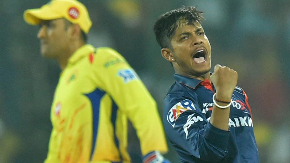 Delhi Daredevils bowler Sandeep Lamichhane celebrates after taking the wicket of Chennai Super Kings' Suresh Raina as MS Dhoni looks on during their Indian Premier League (IPL 2018) match on Friday.