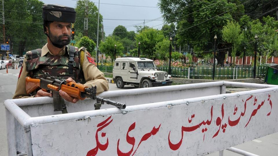 A security personnel stands guard in Srinagar on Friday, a day ahead of Prime Minister Narendra Modi's visit to the city to inaugurate two projects in the state.