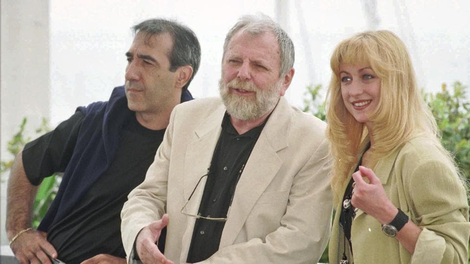 In this May 15, 1996 file photo, Romanian director Lucian Pintilie, center, poses with actors Razvan Vasilescu, left, and Cecilia Barbora before the presentation of his movie Too Late at the 49th International Cannes Film Festival.