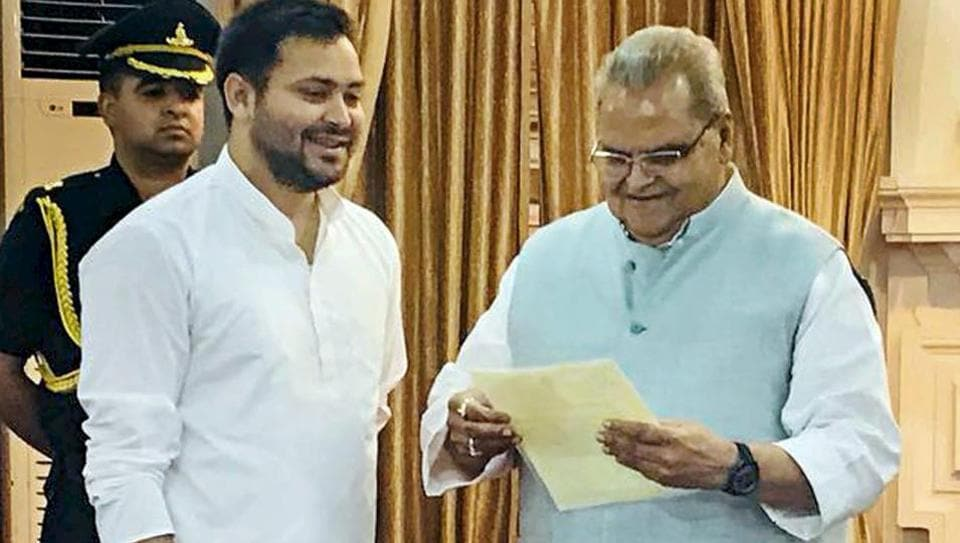 Bihar opposition leader Tejashwi Yadav meets Bihar Governor Satyapal Malik for staking claim to form the government in the state on the grounds of being the single largest party in the Legislative Assembly, in Patna, on Friday.