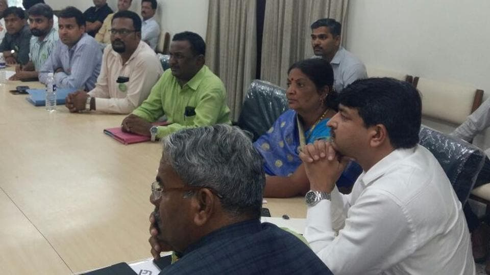 Kiran Gitte (right, in white), CEO, PMRDA, at the meeting held by Wagholi housing societies association to discuss issues related to water supply, garbage disposal and roads.