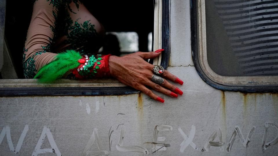 A gay rights activist sits in a bus during the 11th annual March against Homophobia and Transphobia in Havana, Cuba. (Alexandre Meneghini / REUTERS)