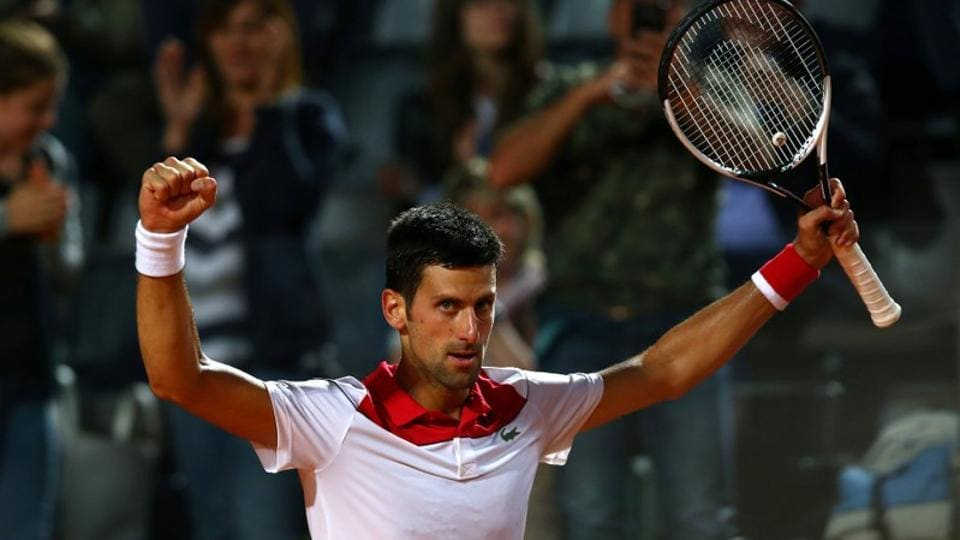 Serbia's Novak Djokovic celebrates winning his quarter final match against Japan's Kei Nishikori. He will face Rafael Nadal in the semis.