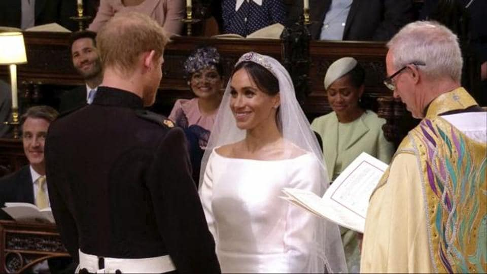 In this frame from video, Britain's Prince Harry and Meghan Markle exchange vows during their wedding ceremony at St. George's Chapel in Windsor Castle in Windsor, near London,   May 19. Even the vows the couple exchanged were different from what they had been when Diana married Charles.