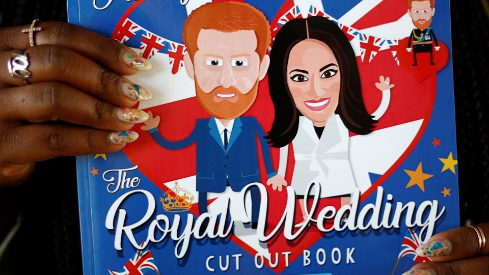 A Harry and Meghan cut out book is among the numerous merchandise that has hit stores ahead of the British royal wedding.