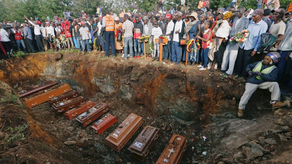 Coffins are seen arranged inside a mass grave during the burial of people killed when a dam burst its walls, overrunning nearby homes, in Solai town near Nakuru, Kenya. (Thomas Mukoya / REUTERS)