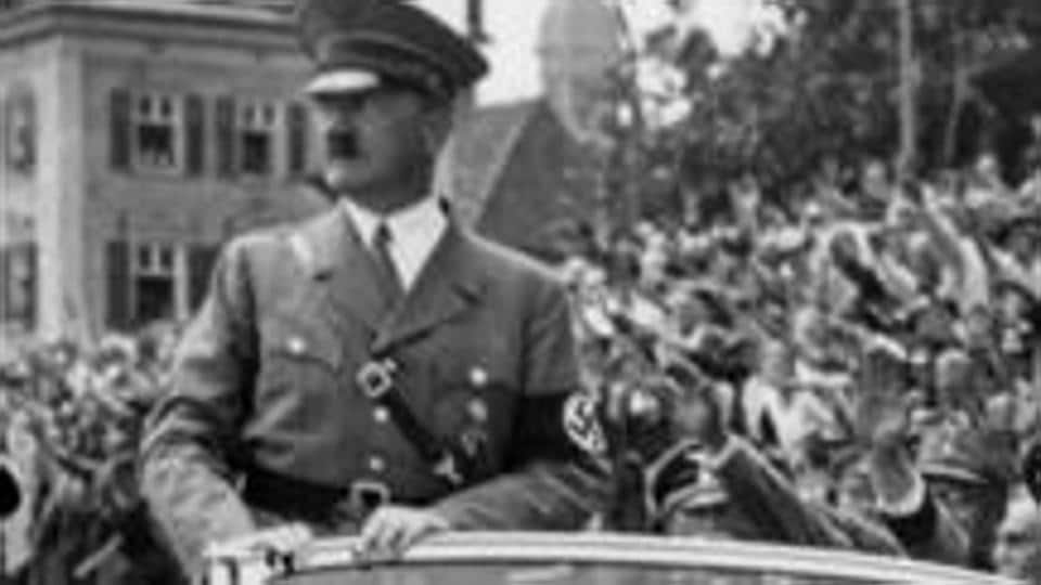 Undated taken from the year 1937 shows German Chancellor Adolf Hitler standing in a convertible Mercedes reviewing SA and SS troops and wellwishers somewhere in Germany.