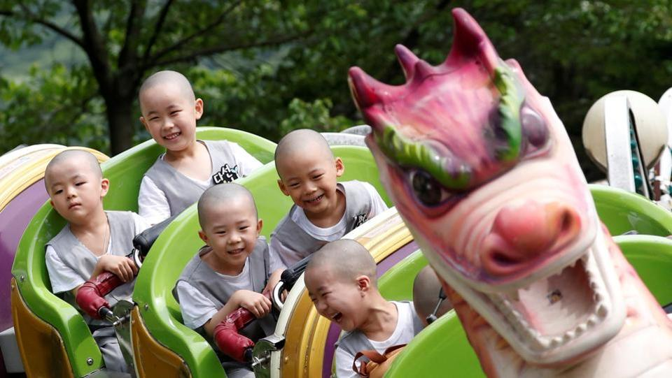Boys, who are experiencing the lives of Buddhist monks by staying in a temple for two weeks as novice monks, enjoy a ride at the Everland amusement park in Yongin, South Korea. (Kim Hong-ji / REUTERS)
