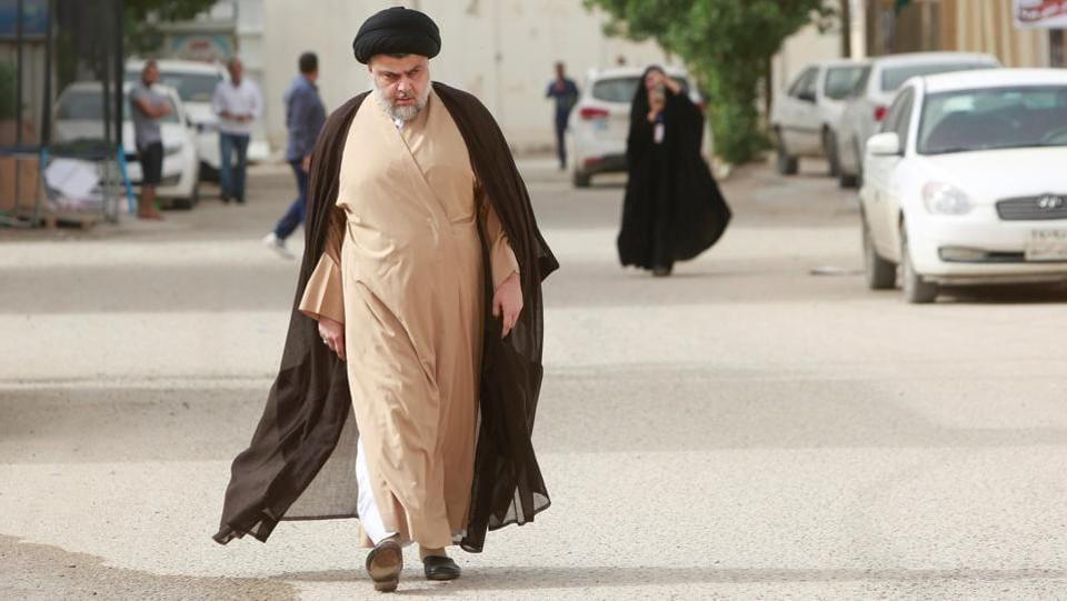 Iraqi Shi'ite cleric Moqtada al-Sadr attends to cast his vote at a polling station during the parliamentary election in Najaf, Iraq. Sadr's Saeroun bloc won a majority in the elections, pegging him at the front of negotiations for the next government. (Alaa al-Marjani / REUTERS)
