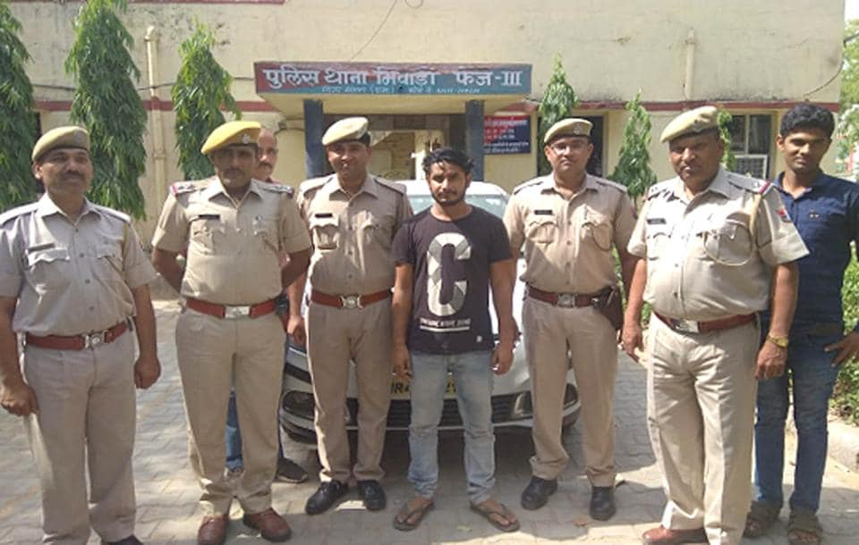 Shakeel Ahmed, 26, the kingpin of a gang that tampers with ATMs for stealing cash,  in Alwar police custody.