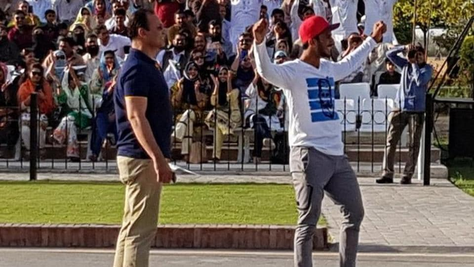 Pakistan cricketer Hasan Ali was seen showing off his trademark wicket celebration during the flag-lowering ceremony at the Wagah border on April 22, which infuriated India's Border Security Force officials.