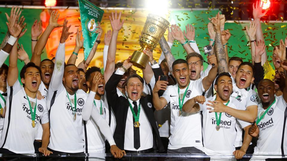 Eintracht Frankfurt coach Niko Kovac and players celebrate with the trophy after winning the DFB Cup  vs Bayern Munich in Berlin on May 19, 2018.