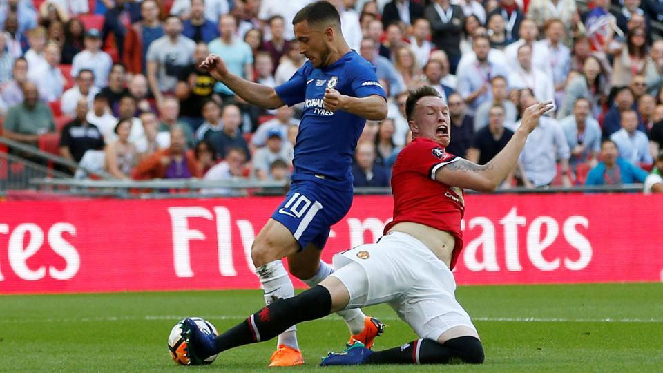 However, the defining moment of the match came when Phil Jones (R) fouled Eden Hazard in the penalty area.  (REUTERS)