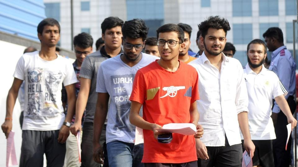 Students come out after appearing for JEE Advance exam, in Noida, on Sunday.