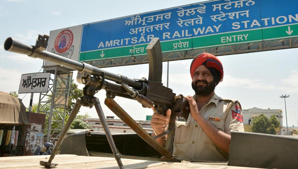 Police personnel stand guard outside railway station, Amritsar on August 26, 2017. August 20, 2017.