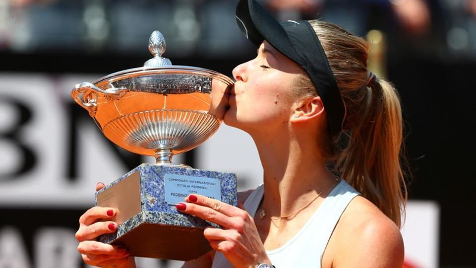 Ukrainian tennis player Elina Svitolina kisses the trophy as she celebrates winning the final against Romania's Simona Halep at the Italian Open in Rome on Sunday.
