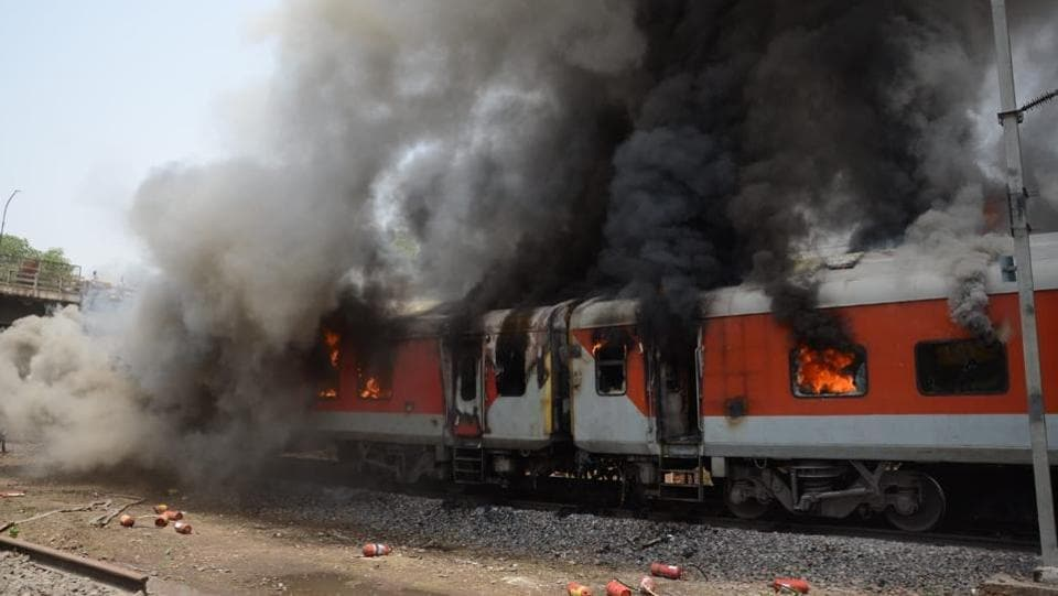 Two coaches of Andhra Pradesh AC Superfast Express going from Hazrat Nizamuddin station in New Delhi to Vishakhapatnam in Andhra Pradesh caught fire near Birlanagar station in Gwalior on Monday. There were no reports of any casualty. (HT Photo)