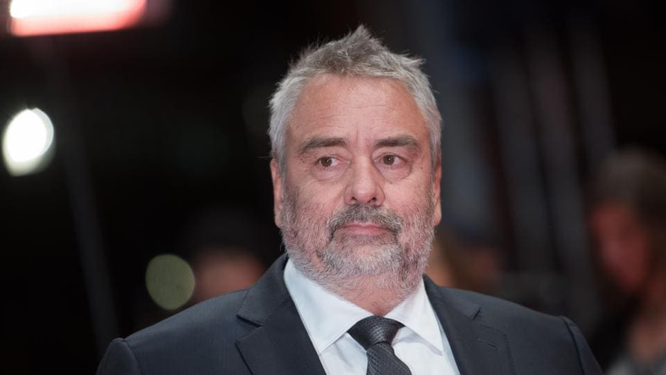 In this file photo taken on February 17, 2018 French director Luc Besson poses on the red carpet upon arrival for the premiere of the film Eva presented in competition during the 68th Berlinale film festival in Berlin.