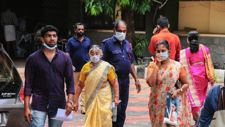 Hospital staff and family members of the patients admitted at the Kozhikode Medical College wear safety masks as a precautionary measure after the 'Nipah' virus outbreak, in Kozhikode, on Monday.