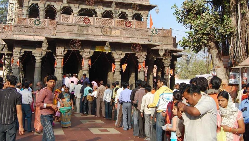 An innocuous act of celebration in Mahakal Temple  in  Ujjain has landed  two women devotees in hot water.