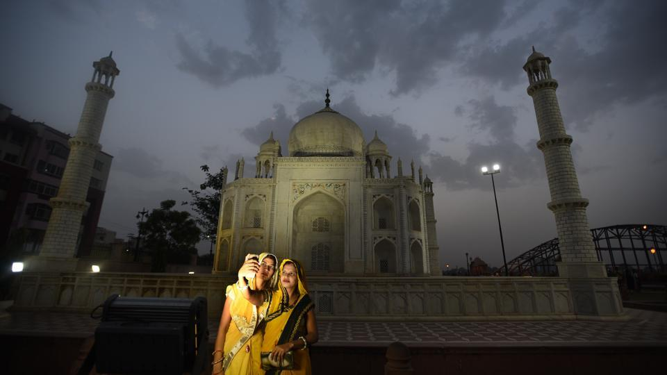 Women take a picture in front of the Taj Mahal, but instead of Agra, this one is in Kota, Rajasthan. Famous as the coaching hub of the country, Kota also claims one of the state's major tourist attractions. Situated on the banks of Kishore Sagar Lake, the Seven Wonders Park packs a world tour in an evening stroll. (Raj K Raj / HT Photo)