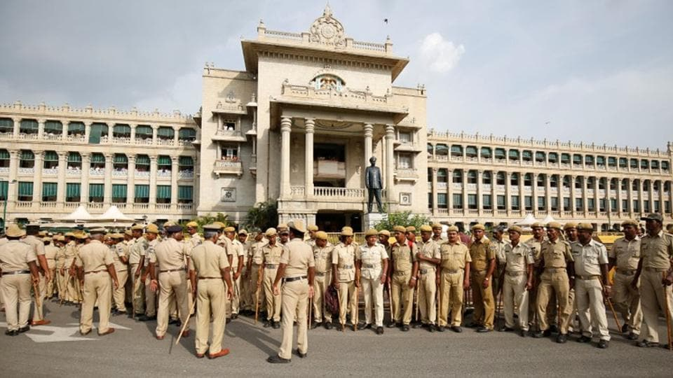 Police personnel maintain vigil outside the Vidhana Soudha of Karnataka during a vote of confidence motion against the Bharatiya Janata Party's BS Yeddyurappa's government in Bengaluru on May 19, 2018.