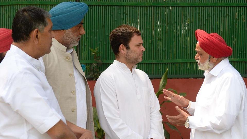 Amrik Singh Dhillon (R) talks to Congress president Rahul Gandhi as (from left) Rakesh Pandey and Randeep Singh Nabha look on, in New Delhi on Tuesday.