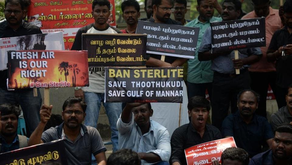Residents along with their children hold placards and shout slogan demanding to shutdown a copper smelter company 'Sterlite' at Thoothukudi in Chennai on April 1, 2018.
