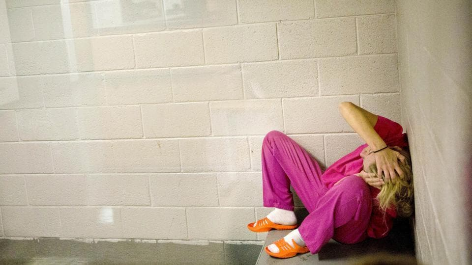 Jessica Morgan, high on methamphetamines and the opioid pain medication Opana, sits in a holding cell after being booked for drug possession at the Tennessee's Campbell County Jail. More than a decade ago, there were rarely more than 10 women inmates here compared to around 60 routinely now –an example of how the opioid epidemic is fuelling the fastest-growing correctional population in America: Women. (David Goldman / AP)