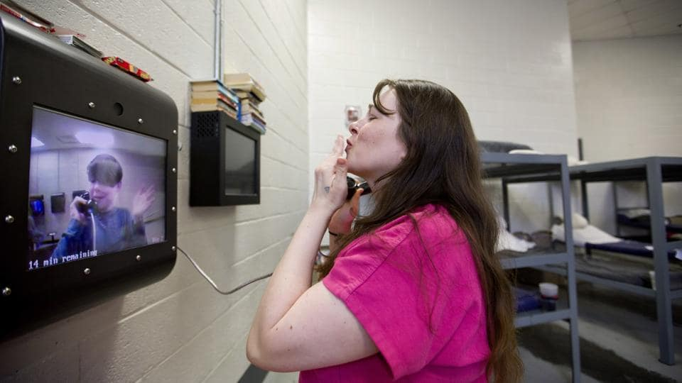 Inmate Krystle Sweat blows a kiss to her son Robby, 10, during a video conference as he visits her at the jail. There are no face-to-face visits other than exceptional circumstances. Robby hasn't hugged or even touched his mother since Christmas Day 2015, just before Sweat wound up back behind bars. In 2015, Campbell County had the third-highest amount of opioids prescribed per person in the nation. (David Goldman / AP)