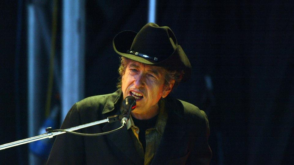 Singer Bob Dylan performs on stage at The Fleadh 2004 at Finsbury Park June 20, 2004 in London. Turning 77 today, Dylan maintains his influence in cementing the culture of the 20th century as a poet, social critic and guiding spirit of the counterculture generation. (Getty Images)