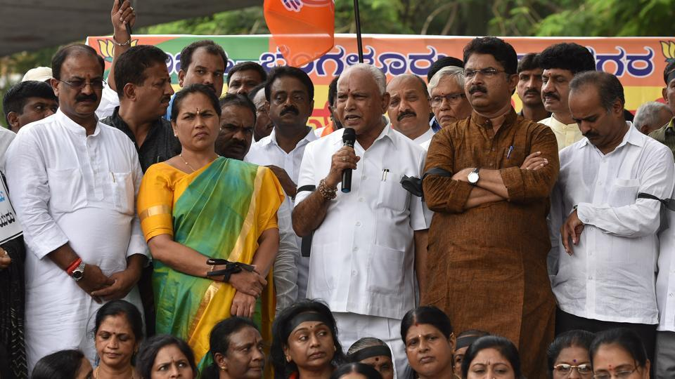 Karnataka BJP chief BS Yeddyurappa (centre) along with BJP State General Secretary Shobha Karandlaje and other party supporters protest against the coalition government by Janta Dal (secular) and Congress, ahead of the swearing-in ceremony of the 24th Chief Minister of Karnataka, H. D. Kumaraswamy at Bengaluru's Maurya Circle. (Arijit Sen / HT Photo)