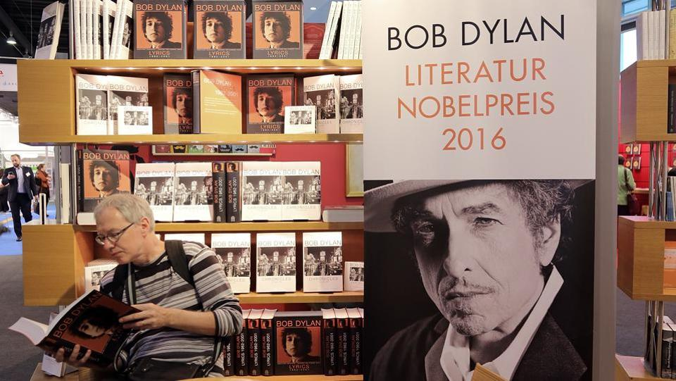 "A man reads a book about Bob Dylan at the 2016 Frankfurt Book Fair. In 2016, Bob Dylan became the first musician to win the Nobel Prize in Literature ""for having created new poetic expressions within the great American song tradition"". After two weeks of silence on his award, Dylan spoke at an interview, calling it ""amazing, incredible. Whoever dreams about something like that?"" (annelore Foerster / Getty Images)"