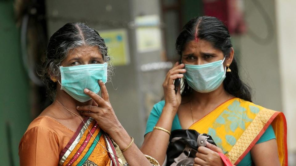 The Kerala government has announced monetary aid of Rs 20 lakh for the family of Lini Puthussery, a 31-year-old nurse who died after attending to those infected with the deadly Nipah virus in the state. Seen here are her relatives wearing masks. Amid the outbreak of the virus, the state government on Wednesday asked travellers to avoid visiting four northern districts of the state -- Kozhikode, Malappuram, Wayanad and Kannur. (PTI)