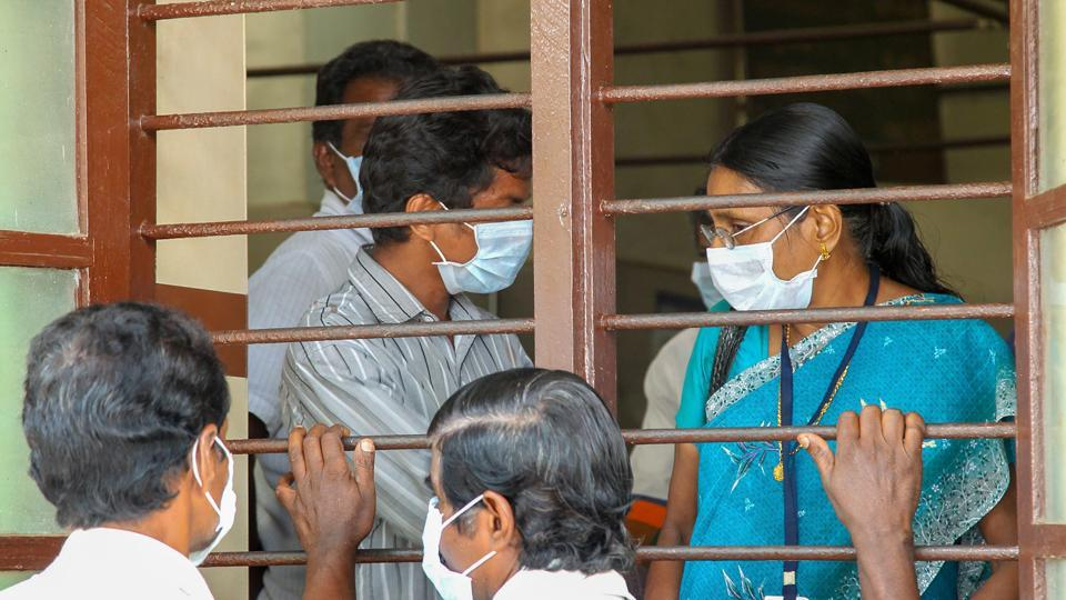 Doctors and patients wear safety masks as a precautionary measure after the 'Nipah' virus outbreak, at a Medical college, in Kozhikode.