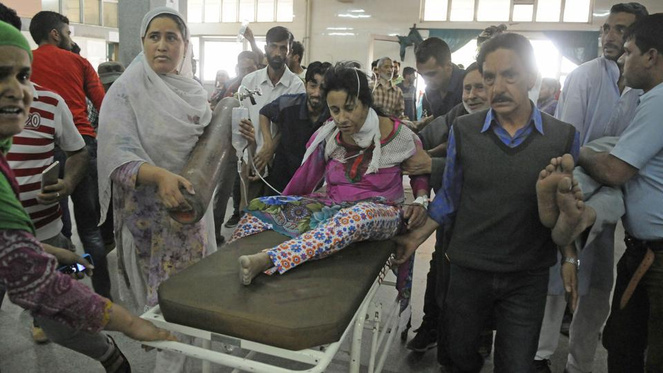 Civilians who were injured in the grenade blast being taken to a hospital in Jammu and Kashmir's Bijbehara town. Police said the militants hurled a hand grenade in Goriwan Chowk of Bijbehara town that left 10 civilians, including a woman and a 12-year-old boy, injured. (Waseem Andrabi / HT Photo)
