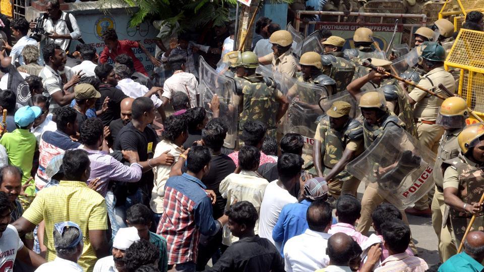 Police personnel tackle a crowd as agitators demand closure of Vedanta's Sterlite Copper unit in Tuticorin, Tamil Nadu, May 22