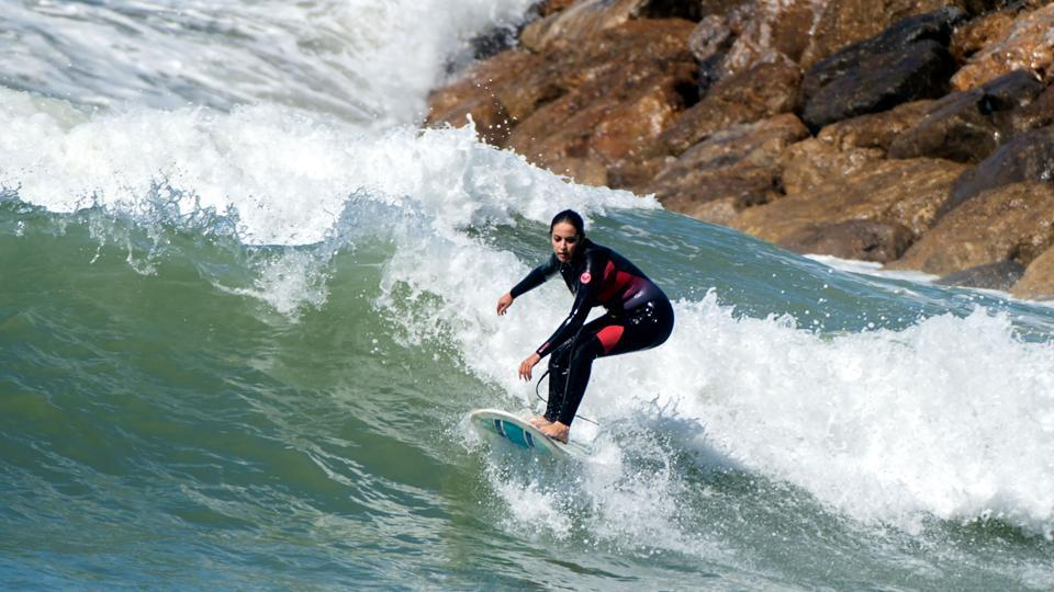 """Women surfers have increasingly become a common sight in Morocco as they skim the waves off the coast of the capital, Rabat. But once back on land they still risk prejudice and harassment. """"It's easier in the winter because the beaches are empty,"""" said 29-year-old Meriem. But as summer approaches the surfers have to pay attention to what they wear. (Fadel Senna / AFP)"""