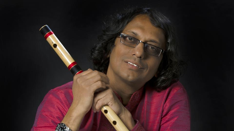Milind Date is a flutist and music composer who plays the bansuri.