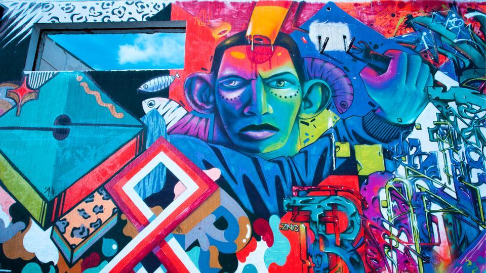 Graffiti artwork with colorful patternson the wall surface in Belgrad.