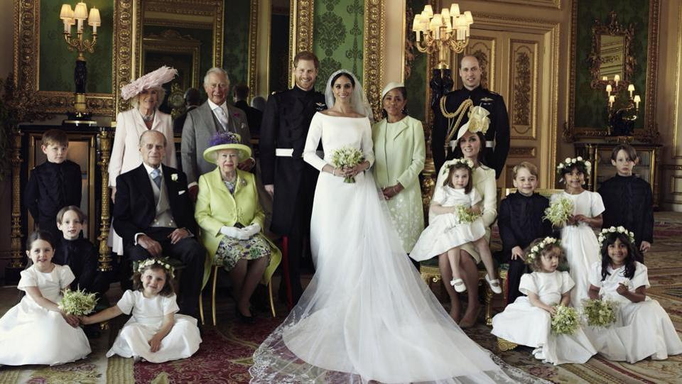 An official wedding photo of Britain's Prince Harry and Meghan Markle (C), and members of the British Royal family at Windsor Castle, England. (Alexi Lubomirski / Kensington Palace via AP)