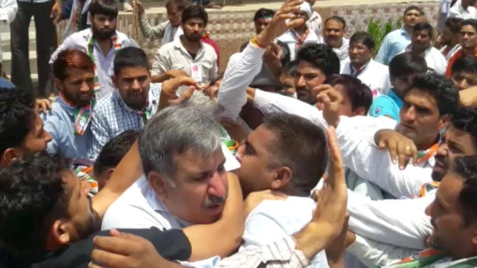 State Congress Kisan cell president Sandeep Choudhary being manhandled by supporters of a local leaders at Shahpura near Jaipur on Friday.