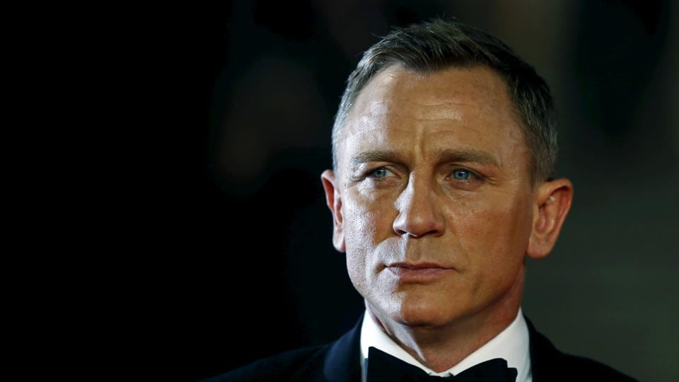 Daniel Craig poses for photographers as he attends the world premiere of the new James Bond 007 film Spectre at the Royal Albert Hall in London.