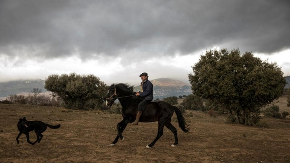 Fernando Noailles gallops on his horse named Madrid in Guadalix de la Sierra. He has spent many years in the Patagonian wilderness living with horses. (Juan Medina / REUTERS)