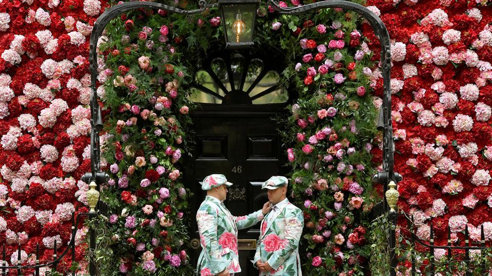 Doormen dressed in floral pattern suits stand on duty outside of Annabel's private members club, adorned with thousands of flowers, timed to coincide with the RHS Chelsea Flower Show, in London, England. (Toby Melville / REUTERS)