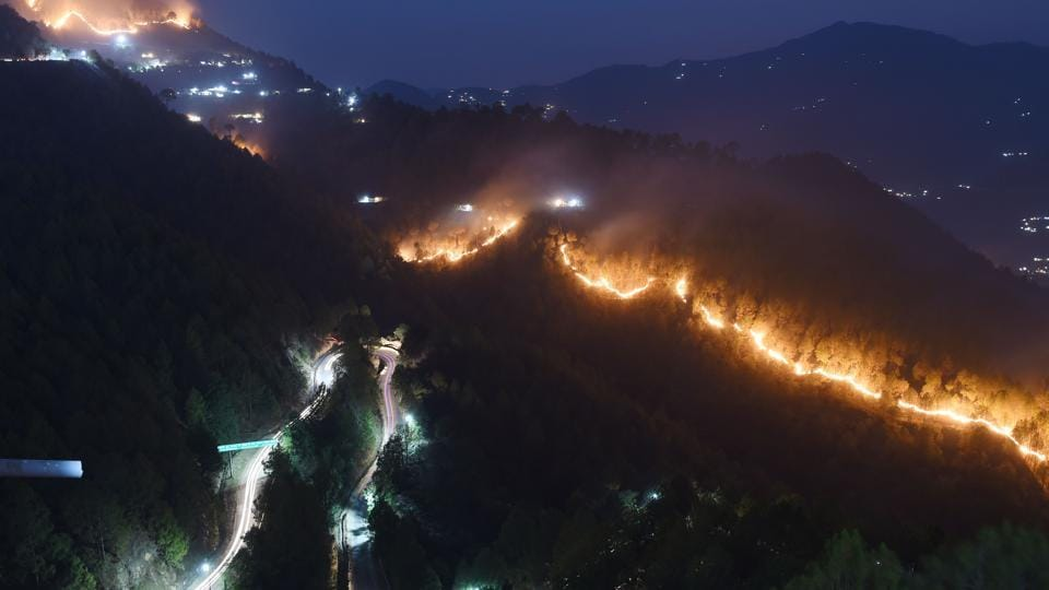 Wildfires burn in the hills around New Tehri at Bourari in Uttarakhand. (Prakash Singh / AFP)
