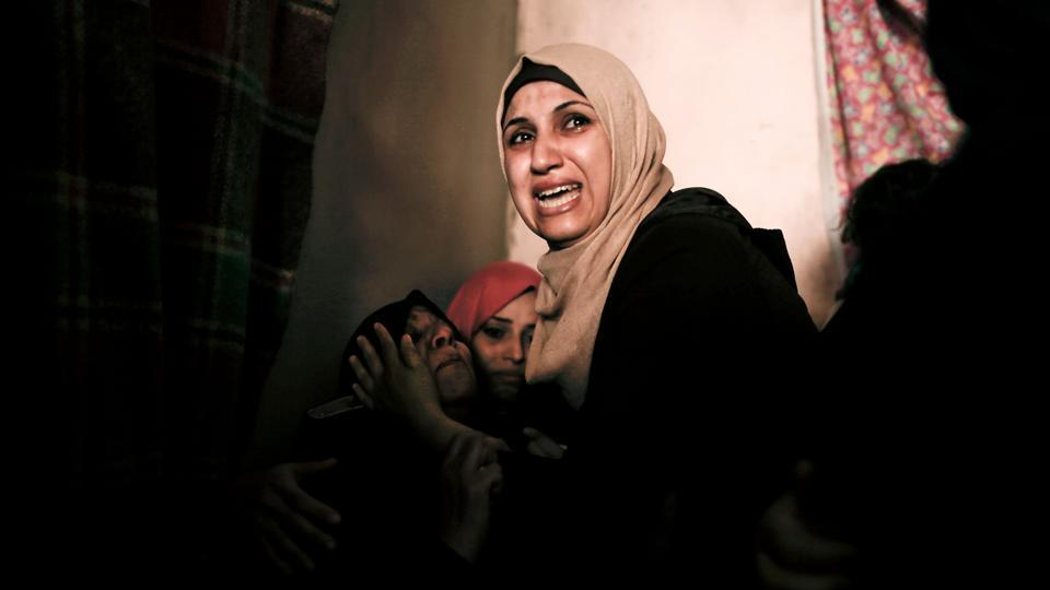 Relatives mourn Palestinian Moein Al-Saai who died of wounds he sustained protesting at the Israeli-Gaza border, during his funeral in Gaza city. (Mahmud Hams / AFP)