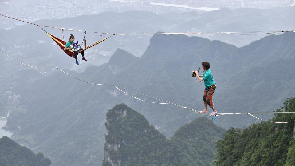Members of performing group Houle Douce practise their instruments on tightropes ahead of a performance, at the Tianmen Mountain National Park in Zhangjiajie, Hunan province, China. (China Daily via REUTERS)