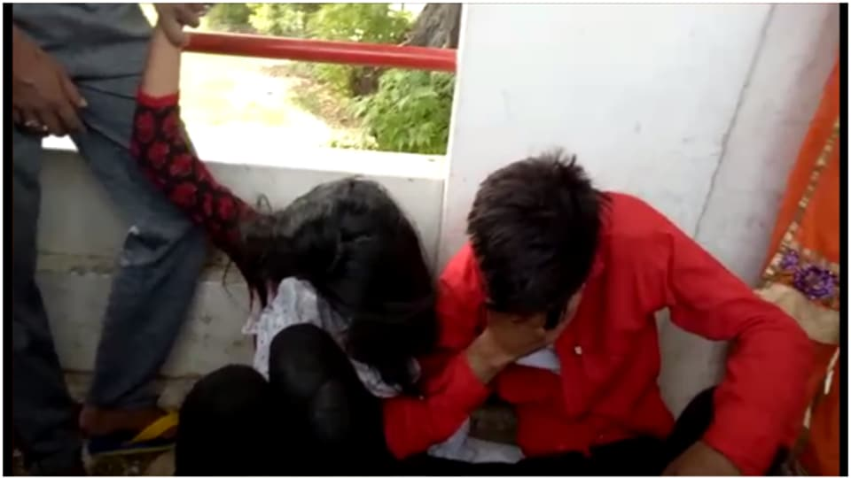 Students couple being thrashed by residents in Sangrur.